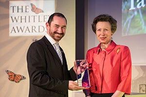 Ian Little, receiving the award from HRM Princess Ann