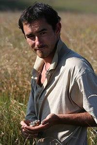Ian Little working in the field