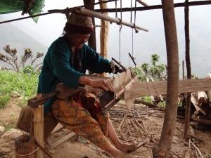 Weaving Nettle to make beautiful fabric.