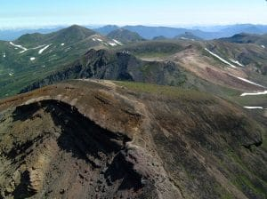 Fig. 1: Mount Asahi-dake (2,291 m), the highest peak in DNP, in the foreground, and the Ohachi-daira caldera in the center (Photo: TW)