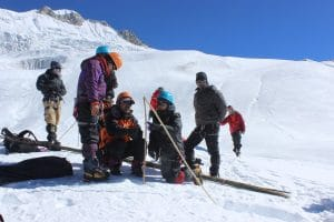 Gunjan Silwal (centre) measuring stake data for glacier mass balance at Yala. Readings on stake measurements help researchers determine whether or not a given year has been a good one for the glacier.